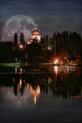 Olympia, Washington.  Moon behind the capitol.  Go to www.YourTravelVideos.com or just click on photo for home videos and much more on sites like this.