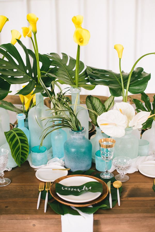 photo by Krista Mason Photography http://ruffledblog.com/tropical-leaves-and-sea-glass-wedding-shoot