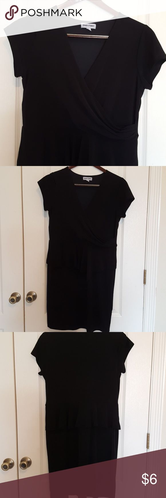 """Black peplum dress This is a versatile style that is very flaterring. It crosses on the chest and has a peplum flounce all around. In good condition. It is 38 1/2"""" long and has 18"""" waist. It would look better on a bustier woman, which I am not. shelby & palmer Dresses Midi"""