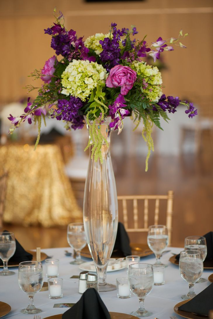 Tall green and purple floral centerpieces photo