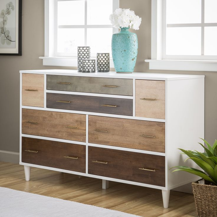Create a unique perspective for your guests with this Christian eight-drawer dresser. The stylish white finish frames the contrasting wood panels with a contemporary grace to unify your home decor with a splash of style.