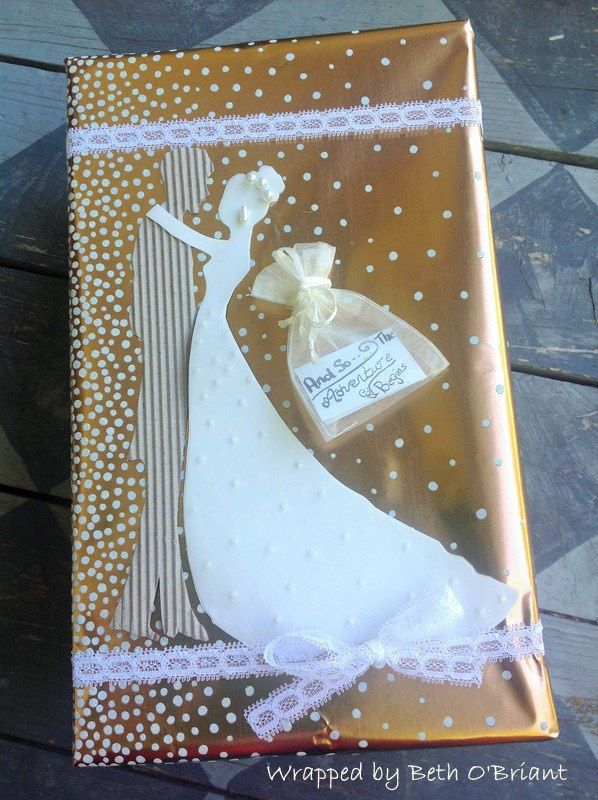 Wedding Gift Wrap w/ Silhouettes | by Beth O'Briant - Groom, cut from corrugated cardboard and bride is 2 layers, a sheer sheet over top plain white with embellished beading. Silhouettes from Googe Images.  Follow me at  http://www.pinterest.com/bethob/wrap-it-up-with-a-little-whimsy/