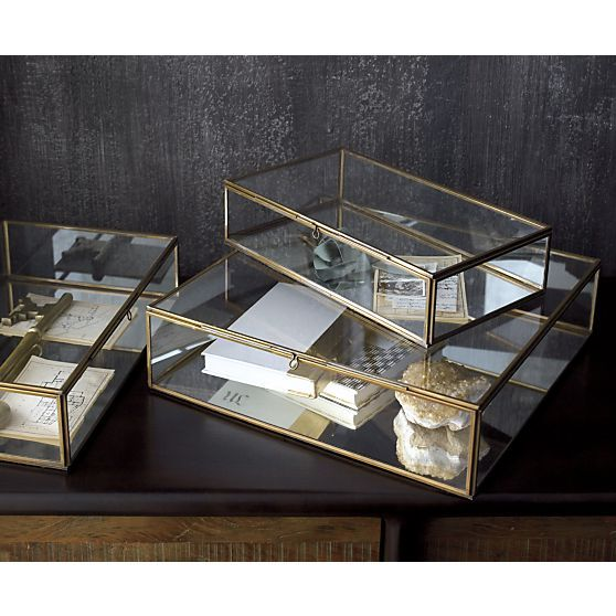 Clear glass framed in warm brass boxes up collectibles, necessities, treasures and trinkets with room for a view. Fill with soil and small plants for an unusual hothouse terrarium.