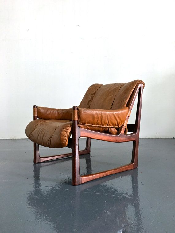 Rosewood lounge chair attributed to Tornjorn Afdal for Nesjestranda Mobelfabrik, 1960s. Sculptural rosewood frame with beautifully distressed camel