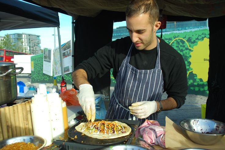 Adam from Rola Wala assembling a half-and-half Goan pulled pork and paneer dal wrap at Kerb, King's Cross, London. Photo: Victoria Burrows One of my lovely boys!