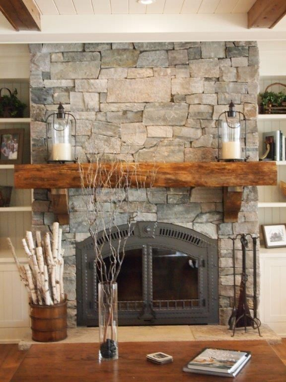 Simply cover an existing fireplace with real thin stone. Natural weather  Muskoka ledgerock veneer.