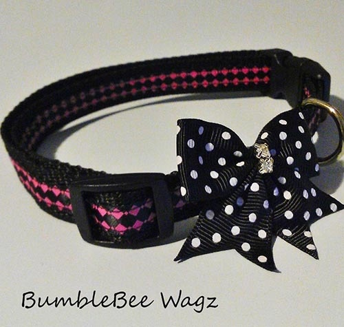 Simply gorgeous pink geographic print collar with black/white polka dot bow. Crystal center adds bling.  5/8' poly webbing repels stains and water. Curved buckle adds maximum comfort to your furry love. Adjustable from 12' to 20'Size (M)As responsible pet parents you should always watch your dog when wearing accessories as some can be a choking hazard or might get ruined during rough playtime!