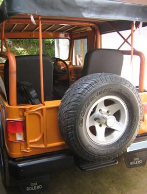 THIS IS A 1988 MODEL MAHINDRA MM540 JEEP.  IT HAS POWER STEERING FROM TATA, A CUSTOM MADE BUMPER, A ROLL CAGE, ALLOY WHEELS AND TUBELESS TIRES.  IT ALSO