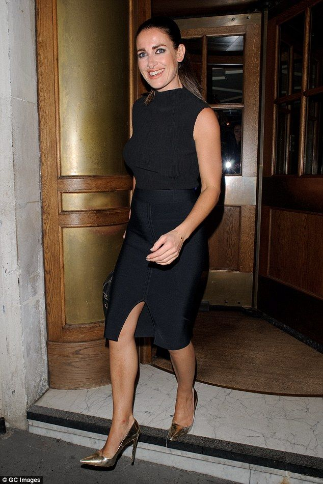 Dressed to impress: Kirsty Gallacher showed off her toned figure in a tight-fitting black top and slit skirt as she left Fortnum and Masons restaurant on Wednesday