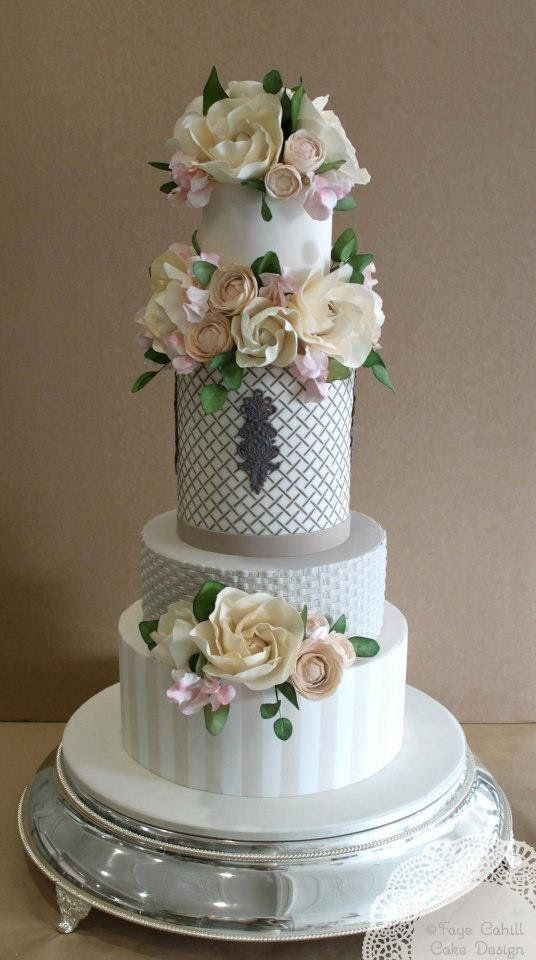 Get ready to feast your eyes on a MAJOR dose of pretty from these beautifully designed wedding cakes with exquisite floral details from Faye Cahill Cake. Take a look and happy pinning!