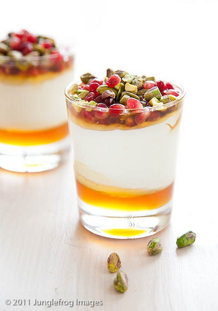 Yogurt pomegranate dessert with honey and pistachio's