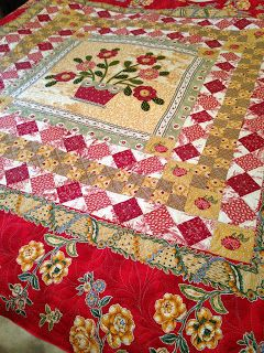 Katrina's Quilting         Julie Cashin  has lovingly sewn this beautiful bright quilt.  The pattern is 'Avignon'  by Di Ford.  I love the green and the bright red colours