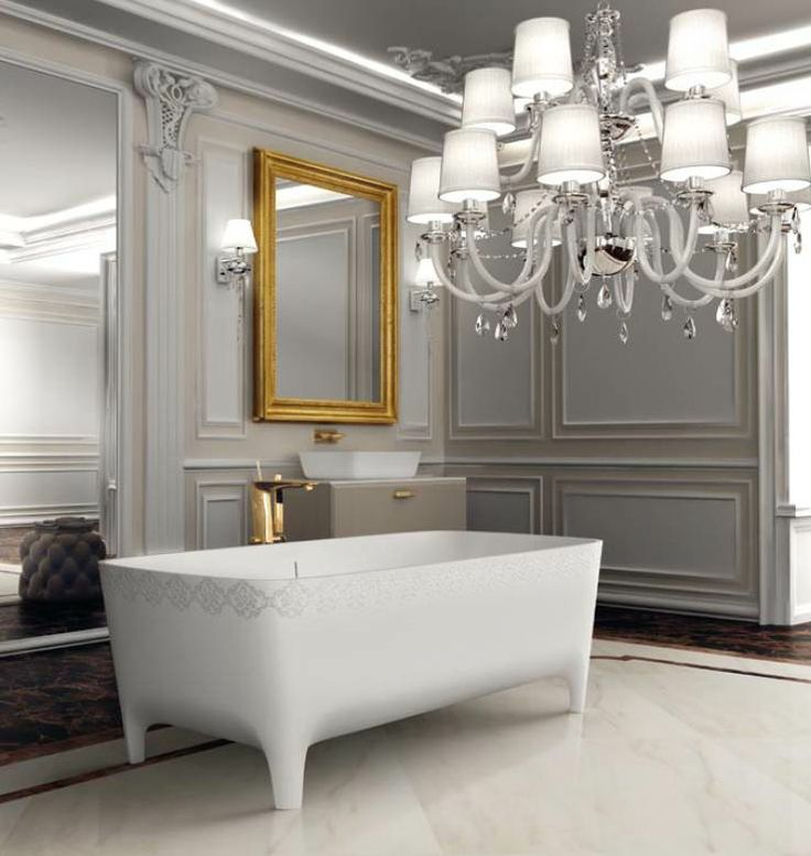 Neoclassical #charme with the golden framed mirror and the crystal chandelier. Decorated with Accademia #bathtub by #Teuco