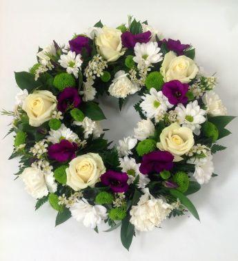 purple and white wreath.