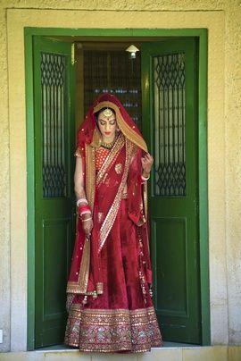 Bridal Lehengas - Bright Red Lehenga | WedMeGood Red brocade blouse and red velvet lehenga with gold border, net dupatta. #wedmegood #bridal #lehenga