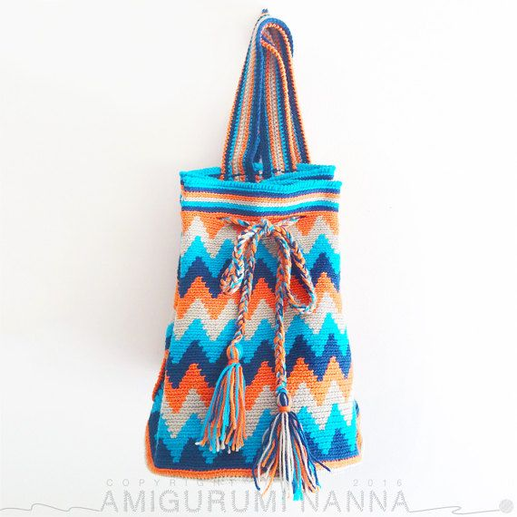 Wayuu Bag - Crochet Bag - Yarn Backpack - Wayuu Tribal Style Bag - Hippie Bag - Tribal Boho Bag - Boho Backpack - Woven Bag - Tribe Backpack This Artisan Navy, Cyan, Beige and Orange zig-zag chevron pattern is reminiscent of its Wayuu Tribe inspiration. This handmade crochet backpack bag is strong and big enough to fit lots of things in! This bag will be a show stopper with its bright colours and hand-made design-truely one of a kind!!! The backpack is a perfect, unique gift for that…