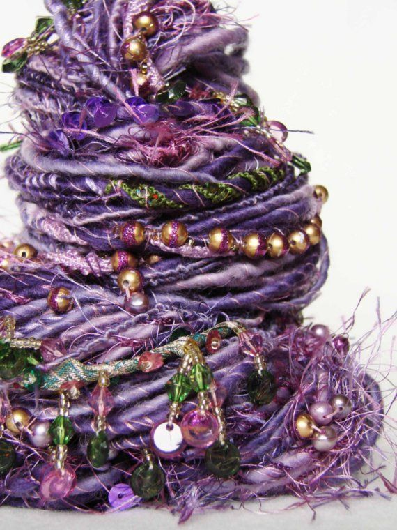 Hand Spun Art Yarn - DEEPSHIKA - by YARNMANTRA  etsy, sold but this is REALLY beading yarn- bigger beads if you have the orifice.