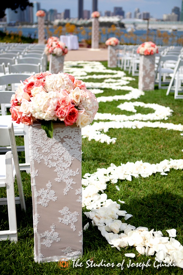 Ceremony Lace Covered Pillars And Flower Petal Design