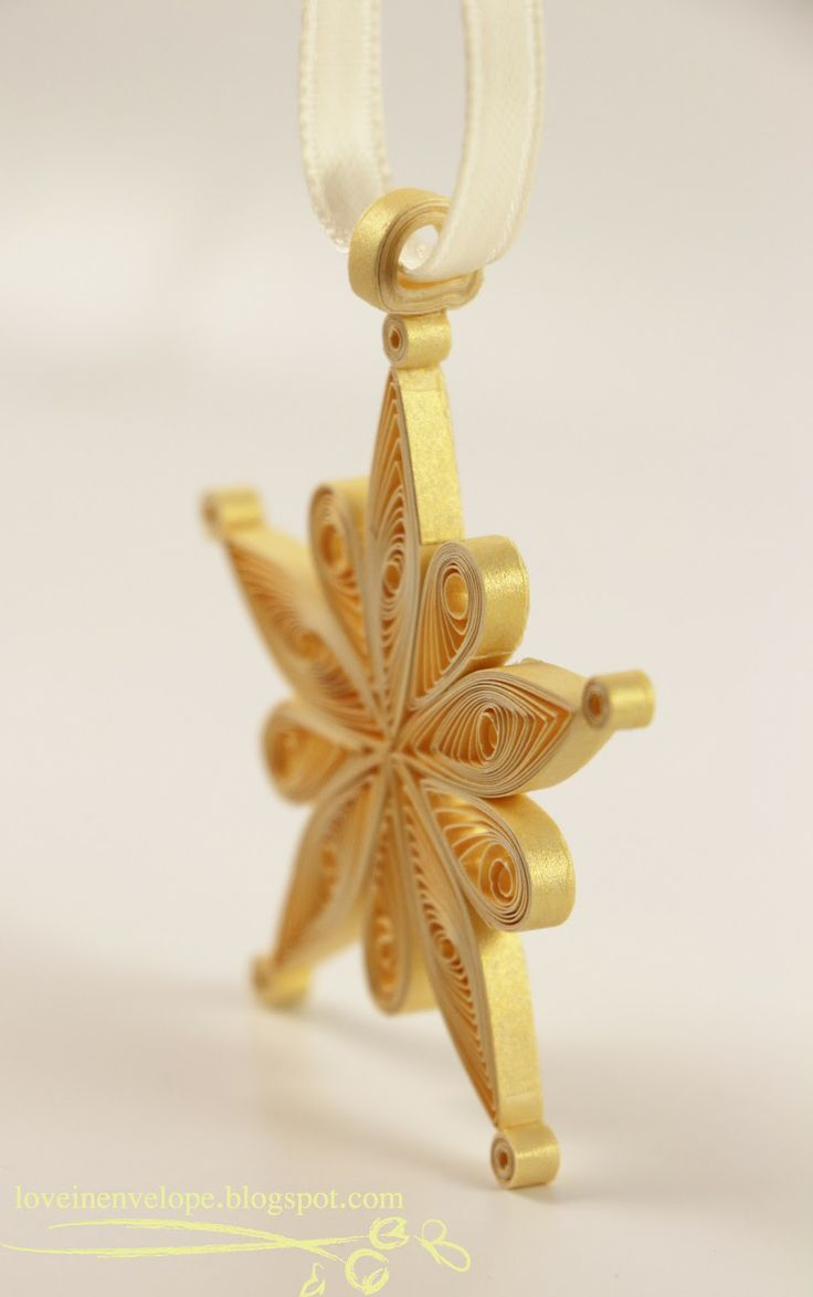 Quilled Gold Snowflake Star Ornament by Eileen Ng.