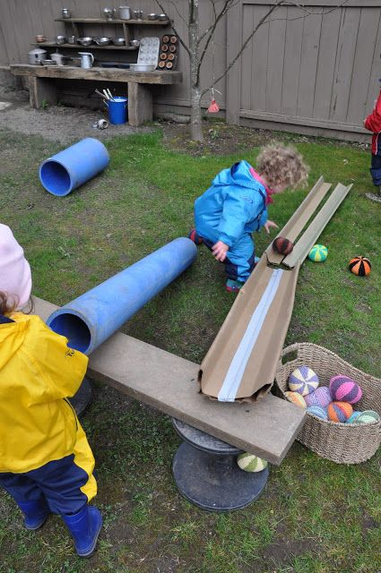 I not only loved the ramp that the children made, but in the background there is an area with several interesting objects in it that could be used for outside play.