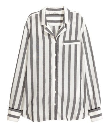 Black & white striped. Shirt in airy woven fabric with wide stripes. Notched lapels, mock chest pocket, and buttons at front. Cuffs with buttons. | H&M | $35