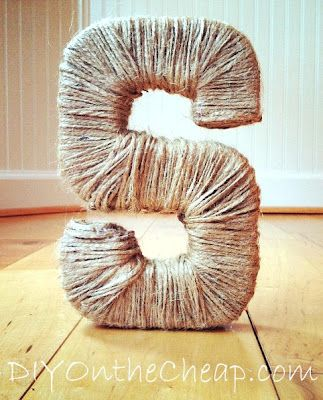 Wrap twine around a cardboard letter for inexpensive monogram art.