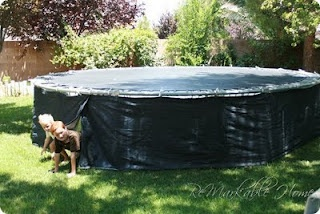 This parent made a drape that runs the circumference of their trampoline. Makes a fun fort for the summer.