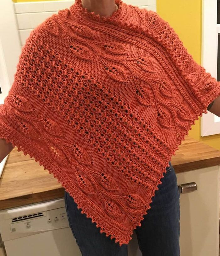 Free Knitting Pattern for Big River Vines Poncho - Poncho featuring leaf lace vines and lace rib is knit flat in two panels and seamed. Aran weight yarn. Designed by Knittingsworth