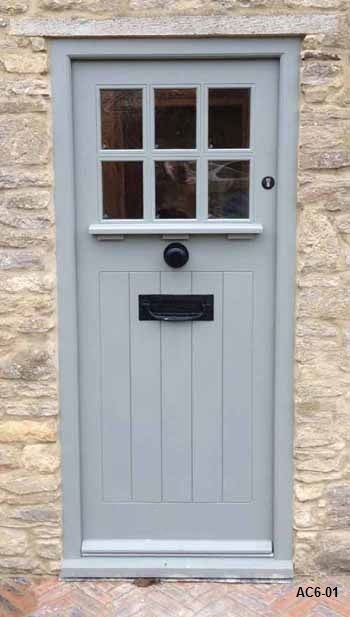 Many Craftsman front doors have only a ledge and dentil molding on the exterior side of the door, much like this beauty.