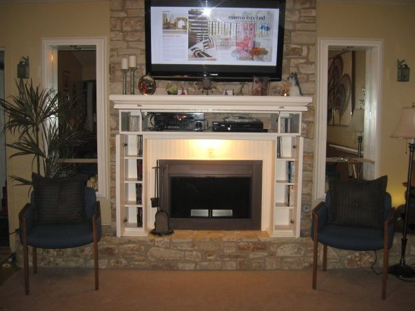 """Fireplace remodel, Started with a brown cedar plank as a fireplace mantel and ended with component,cd and dvd storage for a mantel with 52"""" plasma tv above fireplace."""