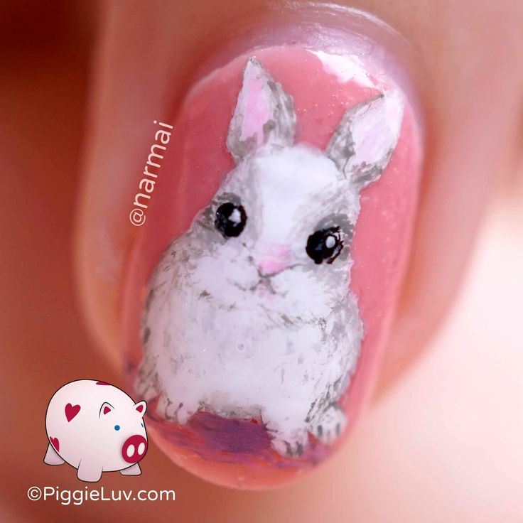Freehand strawberry bunny nail art