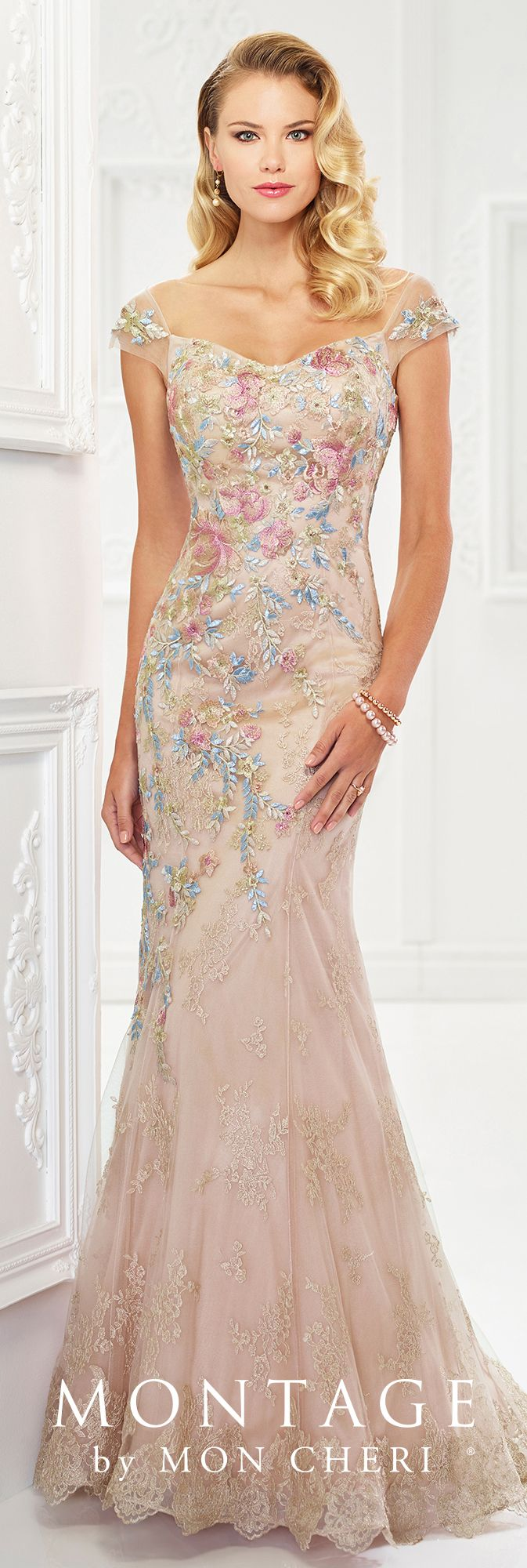Montage By Mon Cheri 118966 - Eye-catching floral embroidery takes center stage in this beautiful metallic lace and tulle fit and flare gown with heat set stones, tip-of-the-shoulder illusion cap sleeves, a soft sweetheart neckline, a dropped waist, a scalloped hem, and a sweep train. A matching shawl is included.