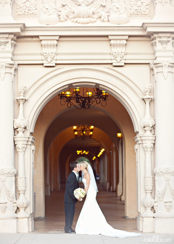 intimate wedding packages atlantga%0A Newlyweds embracing under Balboa Park u    s beautiful architecture Follow Me   www orlandoweddingsinger com  Park WeddingsWedding ImagesProfile