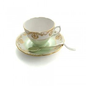 """This sterling silver """"exhausted"""" teaspoon is handmade by Kathryn Hinton and comes with a beautiful porcelain teacup and saucer.  Available from miratis.com"""