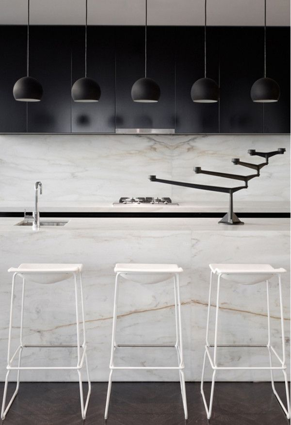 12 Kitchen Counters: The Calacatta marble used in this kitchen has prominent gold veins, adding color to the black and white palette. This unit, as well as the entire building,33 Mackenzie Tower in Melbourne, was designed byarchitects Callum Fraser and Zahava Elenberg ofElenberg Fraser.