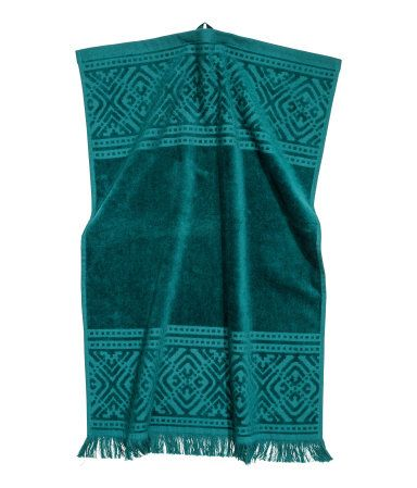 Teal. Hand towel in cotton terry with a jacquard-weave pattern. Hanger loop on…
