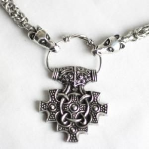 $ 85.00 Hiddensee Pendant on Dragon Chain This pewter pendant is based on a Viking age find from York. It is very similar to a number of gold pendants probably manufactured in Denmark and found in Hiddensee, Germany, which gives it its name.