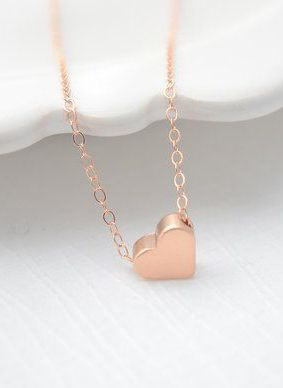 Rose Gold Heart Necklace rose gold necklace...I have a little gold heart just like this but with my initial carved into it.