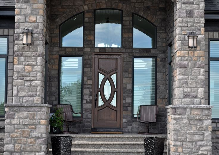 luxury home entrance brick home entrance brown wood door