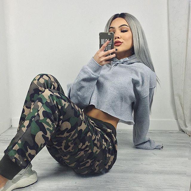 Crop top sweater, camo print pants, and nike huaraches.