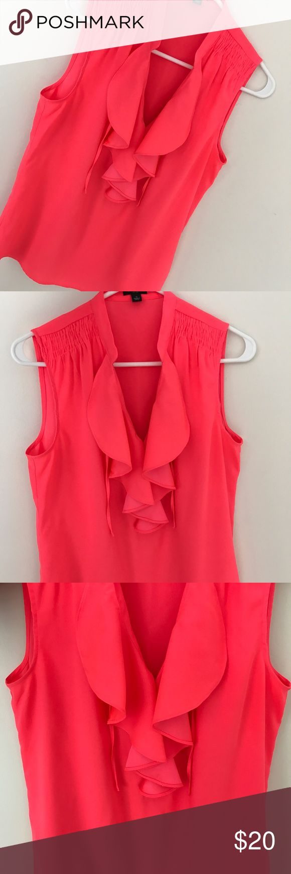 Ann Taylor neon top This is a great summer top in a neon pink/peach color. The true color is very difficult to capture in a picture(I did my best while photographing it). Top has beautiful ruffles and looks amazing paired with white pants in the summer! It is in perfect condition with zero flaws. Size S Ann Taylor Tops Blouses