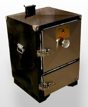 Backwoods Smoker Chubby | The walls are well insulated, the door latches tight, there's a clever reverse flow heat and smoke transit system, temp control is incredibly simple, and it can hold standard hotel pans. A water pan between the charcoal and the food keeps the cooking chamber moist.