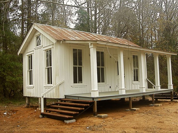 I would love something like this on a couple of acres. A little Greek Revial cottage. Just 2 or thee rooms and a porch for weekends.