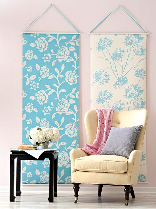 Hanging Wallpaper  Make wallpaper less permanent by hanging in as vertical artwork. Anchor the top and bottom to small rods then use ribbon to hang it in place.