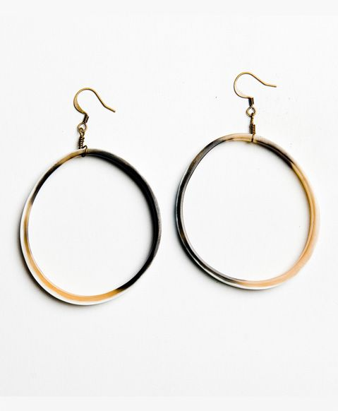 Carved from the tremendous cow horns found in Uganda. Each earring is hand cut from a different part of the horn, making every pair truly unique. Handmade by African Style, a group that Noonday Collection helped launch in Uganda.