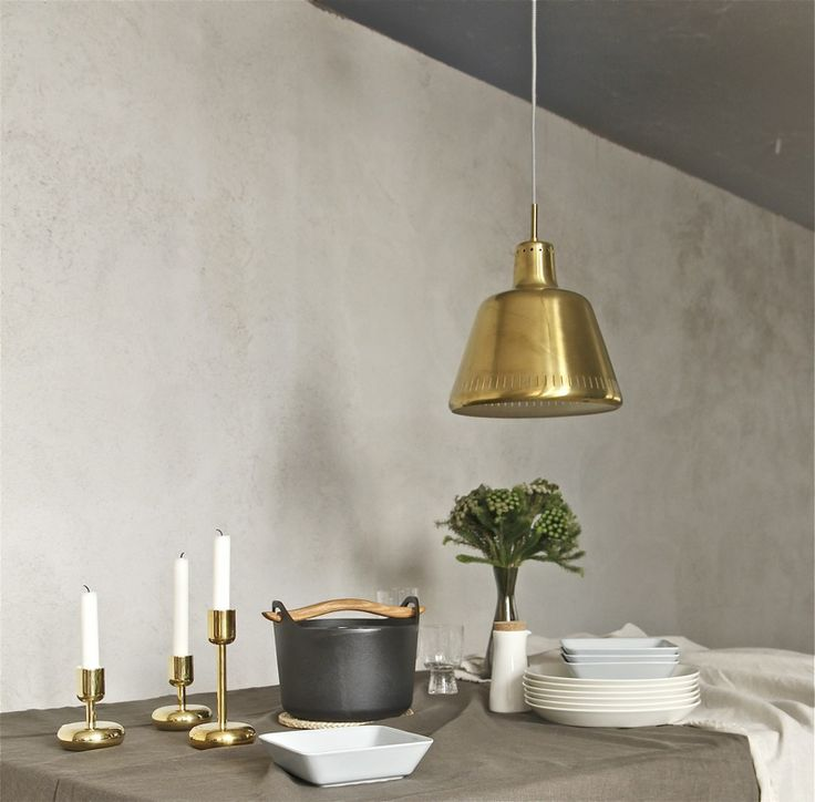 Sarpaneva cast iron pot and Nappula candleholders by Iittala. From the blog Time of the Aquarius.