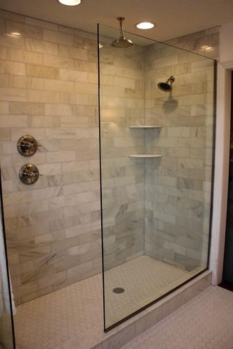 Marble Subway Tile, Doorless walk-in, double shower heads, hexagon floor tile. We should change our shower!