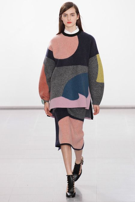 Issa | Fall 2014 Issa at London Fall 2014 Issa's Fall 2014 collection explores the breakdown of extremely simple intuitive shapes into colours. These shapes in large scale across a voluminous silhouette expresses naivety.