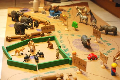 Cute DIY zoo play scene to make with the kids. This would be a fun rainy day activity. My daughter and I did a zoo with bigger animals and legos for fences. Took up the entire living room, was awesome. This would be a nice table activity