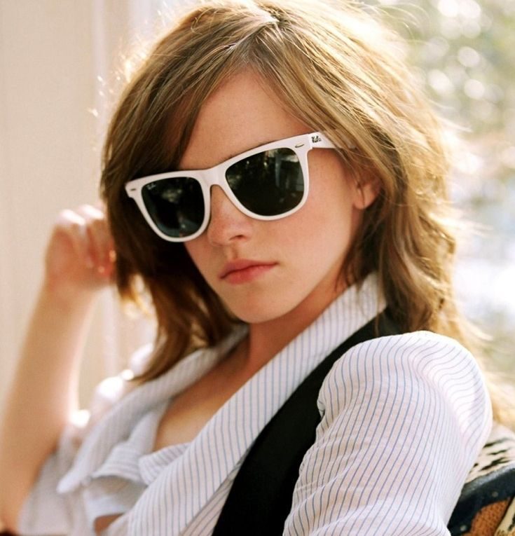 Hermione Granger, I mean Emma Watson, wearing white ray ban sunglasses